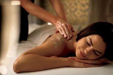 woman having a body massage in imperial spa