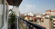 suite room with balcony hanoi city view