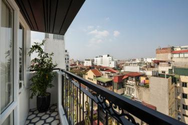 suite room with balcony hanoi city view