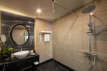 suite balcony room bathroom standing shower