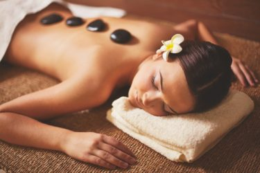 woman having a hot stone massage