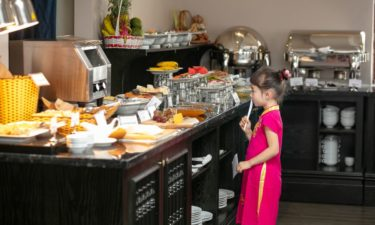 a child choosing bread in the buffet